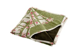 Patchwork green-white quilt on a white background. Patchwork blanket. Handmade. Patchwork quilt on a white background.