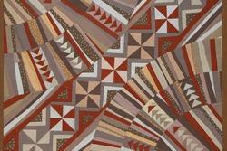 Patchwork handmade carpet. Geometrical ornament. Patchwork handmade carpet. Ethnic decor, colorful patchwork. Patchwork handicraft, craft. Traditional ational folk textile. Carpet in russian style