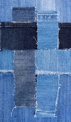 Patchwork in denim textile, vintage pattern with many jeans samples, white tattered