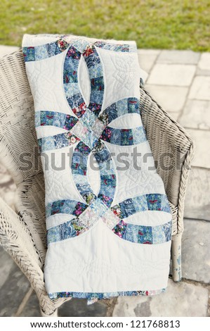 patchwork quilt draped over chair