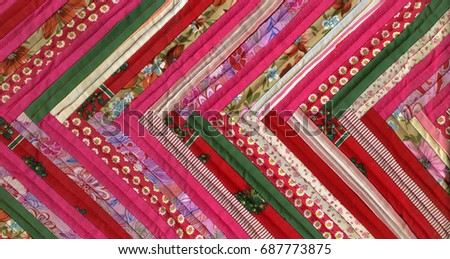 Patchwork texture. Mixing of different fabrics and patterns. #687773875