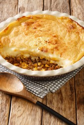 Pate chinois is a French Canadian dish similar to the English shepherd's pie it is a traditional recipe in both Quebec cuisine closeup in the baking dish on the table. Vertical
