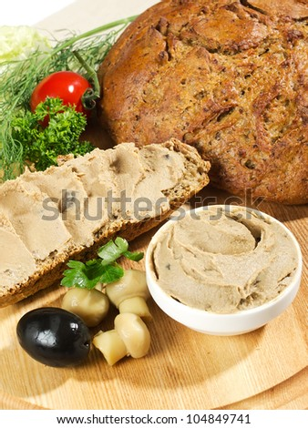 pate' on bowl with bread and vegetables