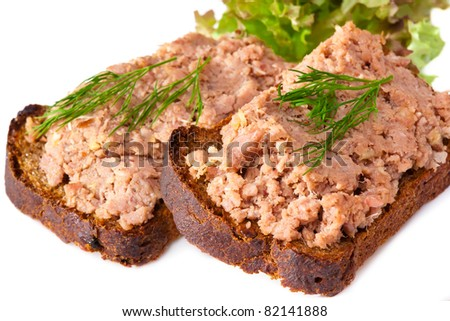 pate with a bread and green salad