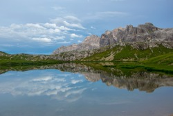 Paterno mountain reflected in smooth surface water of Laghi dei Piani - Lakes Piano, Southern Tyrol, Dolomites, Tre Cime di Lavaredo National Park, Italy