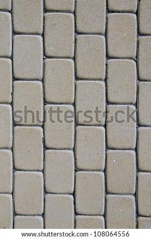 Path background fragment. Path made of small grey bricks.
