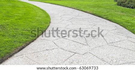 path curving through lawn in park