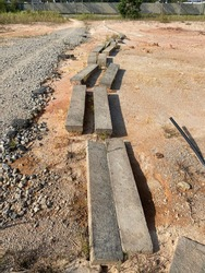 Path in the construction site is made of concrete slabs.