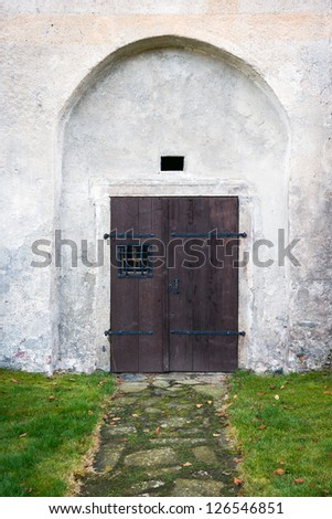 path leading to ancient wooden door