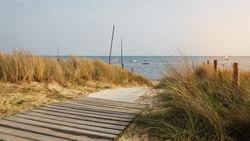 Path leading to the beach with the sea in background.