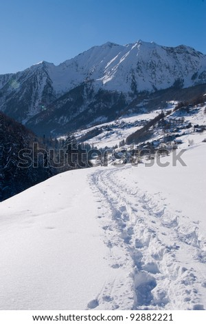 Path on a fresh snow covered valley
