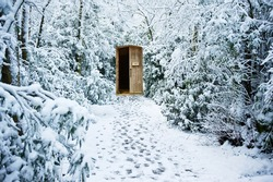 Path through winter forest leading to secret hidden door
