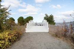 Path to a white arched bridge in the middle at Tacoma, Washington