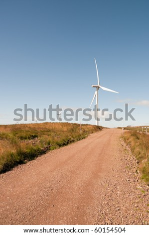 Path to a wind turbine on a wind farm in Scotland, Europe.