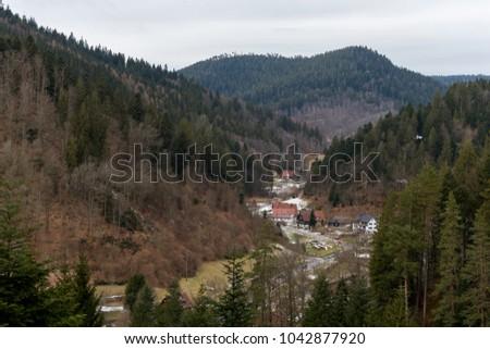 path to Burgbach waterfall frozen in wintertime in Germany in Bad Rippoldsau #1042877920
