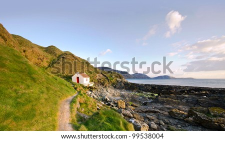 Path to the White Fisherman Cottage on a coast - Niarbyl on the Isle of Man