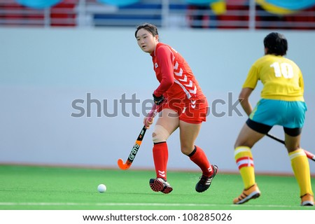 PATHUM THANI,THAILAND-JULY  3:Hong Jiseon (Red) of Korea handles the ball during the Women�s Junior AsiaCup Korea and Kazakhstan at QueenSirikit Stadium on July3,2012 in PathumThani,Thailan d. - stock photo