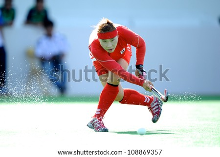 PATHUM THANI,THAILAND-JULY 3:Kim Mi Ri (no.4 Red) of Korea hits the ball during the Womens Junior AsiaCup Korea and Kazakhstan at QueenSirikit Stadium on July3,2012 in PathumThani,Thailand.