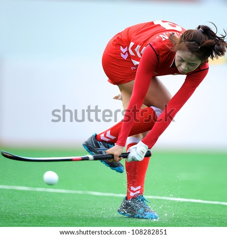 PATHUM THANI,THAILAND-JULY 3:Lee Hana (Red) of Korea hits the ball during the Women�s Junior AsiaCup Korea and Kazakhstan at QueenSirikit Stadium on July3,2012 in PathumThani,Thailand.