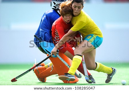PATHUM THANI,THAILAND-JULY 3:lipunova Symbat no.11(Y)of Kazakhstan tackles  during the Women�s Junior AsiaCup Korea and Kazakhstan at QueenSirikit Stadium on July3,2012 in PathumThani,Thailand.