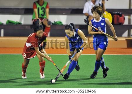 PATHUM THANI THAILAND-SEP20:Maeda Yukina(R) during in ptt grils asia cup 2011(U18),Jap(R) Vs Kor(B) at Commemoration Of Queen Sirikit Sports Stadium on Sep20,2011 in Pathum Thani Thai