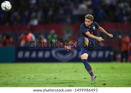 PATHUM THANI THAILAND SEP 5:Theerathon Bunmathan of Thailand in action during the 2022 FIFA World Cup Asian second qualifier match between Thailand and Vietnam at Thammasat Stadium