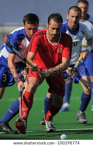 PATHUMTHANI THAILAND-APRIL16:Douglas Corbel (front) of HKG in action during The Fourth men's ptt AHF cup betaween HKG(R) and UZB(W) at  Queen Sirikit Sports Stadium on April 16,2012 in Thailand