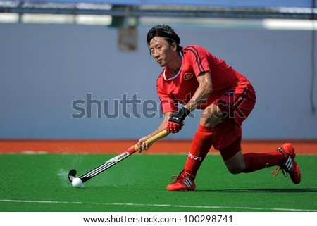 PATHUMTHANI THAILAND-APRIL16:Ka Ho Chan of HKG in action during The Fourth men's ptt AHF cup betaween HKG(R) and UZB(W) at  Queen Sirikit Sports Stadium on April 16,2012 in Pathumthani Thailand