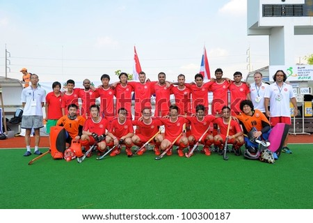 PATHUMTHANI THAILAND-APRIL16:Pl ayer of HKG pose for a photo  during before The Fourth men's ptt AHF cup betaween HKG(R) and UZB(W) at  Queen Sirikit Sports Stadium on April 16,2012 in Thailand - stock photo