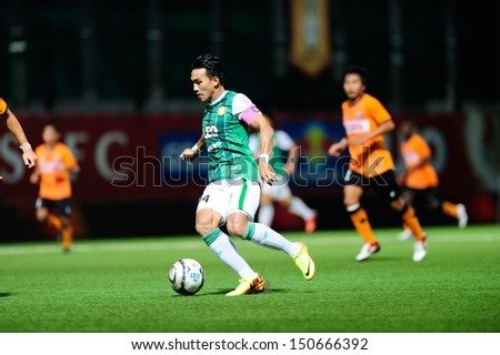 PATHUMTHANI,THAILAND AUG 2013 : Teeratep Winothai of BGFC in action during geam Toyota Thai premier League 2013 between Bangkok Glass FC and Samutsongkham FC at Leo Stadium on Aug 14,2013 in Thailand