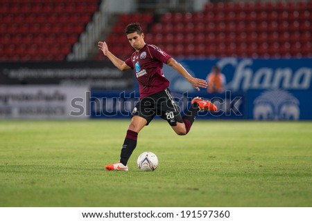 PATHUMTHANI THAILAND-MAY 05:Sergio Suarez of Police Utd.runs for the ball during  Thai Premier League match between Police Utd.and Songkhla Utd.at Thammasat Stadium on May 05,2014,Thailand