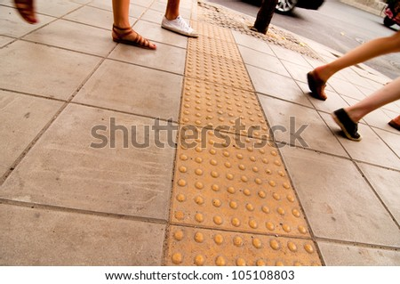 Pathway in Thailand with concrete bumps for blind pedestrians
