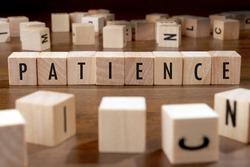 PATIENCE word written on wood block