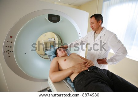 Patient and doctor ready to do CAT scan with CT scanner.