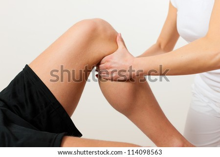 Patient at the physiotherapy doing physical therapy exercises with his therapist
