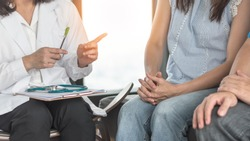 Patient couple consulting with doctor or psychologist on marriage counseling, family medical healthcare therapy, In vitro fertility IVF treatment for infertility, or psychotherapy session concept
