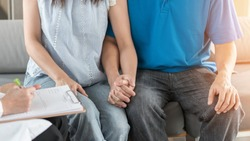 Patient couple having doctor or psychologist consulting on marriage counseling, family medical healthcare therapy, fertility treatment for infertility, IVF insemination, psychotherapy session concept