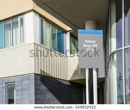 Patient Drop-Off sign outside hospital entrance
