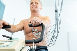Patient during exercise ECG on stationary bike