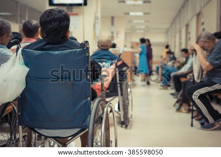 Patient elderly on wheelchair and many patient waiting a doctor and nurse in hospital , process in vintage style