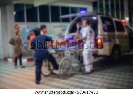 patient emergency with team transfer from ambulance ,blur - Shutterstock ID 560619430