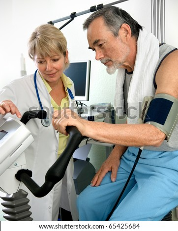 Patient is being observed by doctor - EKG test