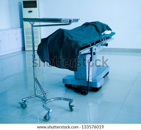 patient lying on bed waiting for operation.