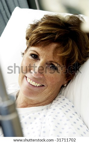 Patient on hospital bed smiling