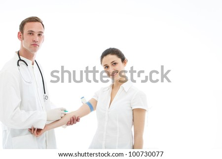 Patient receiving an intravenous injection from a young male doctor or nurse
