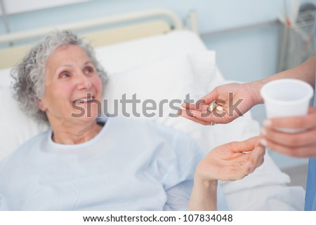 Patient receiving drugs in hospital ward