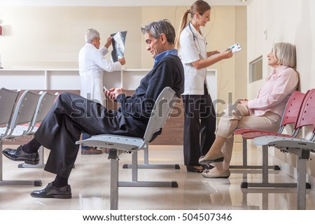 Patients and doctors speaking inside hospital waiting room. #504507346