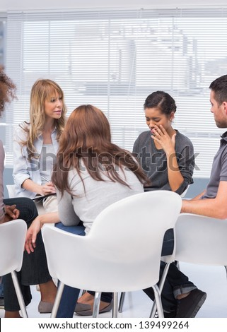 Patients and therapist listening to woman telling her problems