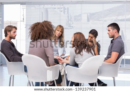 Patients around therapist telling their problems in group therapy session