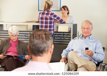 Patients In Doctor\'s Waiting Room
